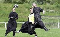 Seminarists from the Seminary of Econe the International Seminary of Saint Pius X, play soccer during a game, in Riddes